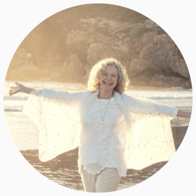 Photo of Joy at the beach smiling with light radiating